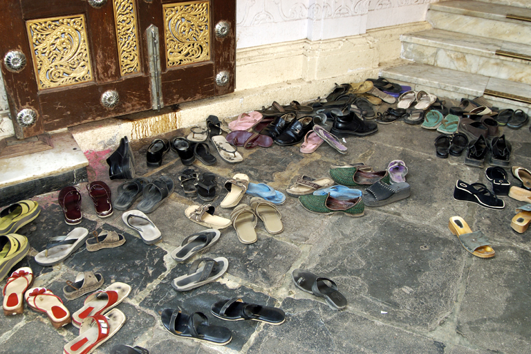 111d2b45f69c Outside the Madhavbaug temple in Bombay. Shoes are not allowed in temples